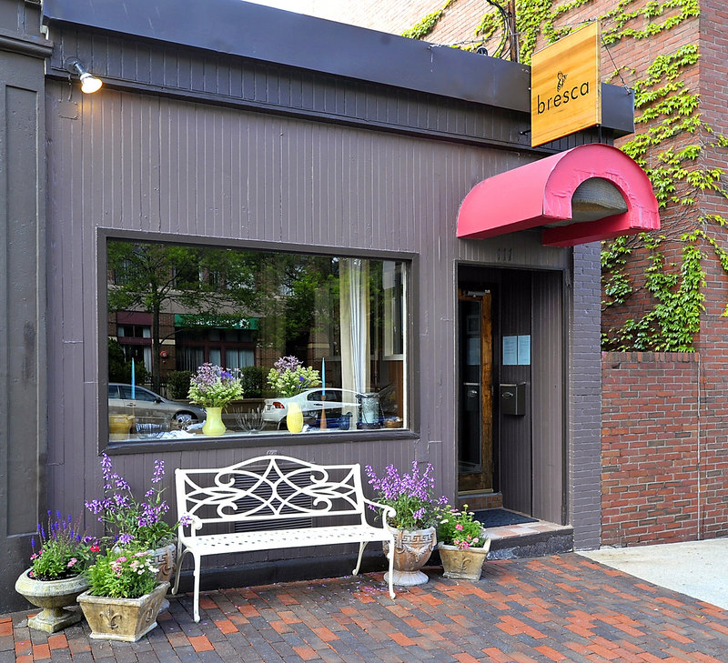 An iron bench surrounded by flowered pots adorns the sidewalk outside Bresca at 111 Middle St. in Portland. Inside, the atmosphere evokes an Old World simplicity and elegance.