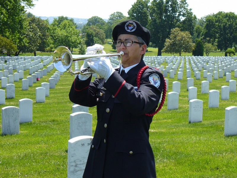 """Carla Beaudoin joined other members of Bugles Across America May 19 to play """"Taps"""" at Arlington National Cemetery in celebration of the 150th anniversary of the piece."""