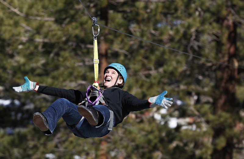 Andrea Grieve celebrates her third wedding anniversary by ziplining in Big Bear, Calif. Zip lines have become such a boom industry, particularly in California, that a private group is setting new voluntary safety standards.