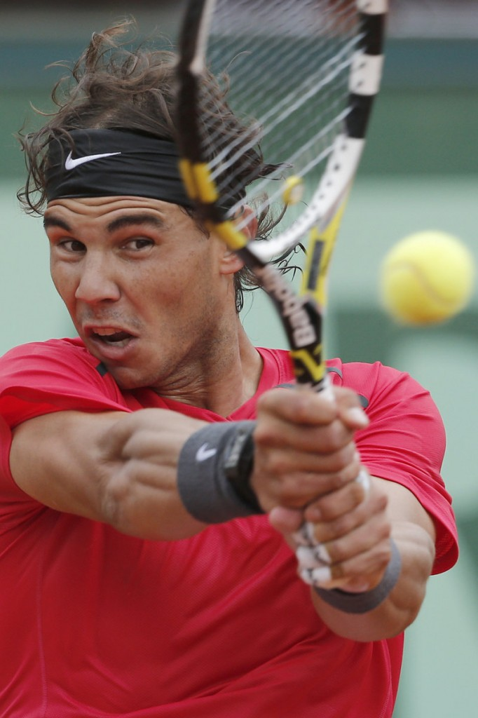 Rafael Nadal returns a shot against Nicolas Almagro in the French Open quarterfinals Wednesday in Paris. Nadal advanced, 7-6 (4), 6-2, 6-3.