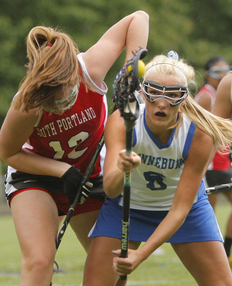 Rose Bryant of Kennebunk recovers the ball while battling with Mary Alice Gurnee of South Portland during their Western Class A quarterfinal Wednesday. Kennebunk won, 12-5.