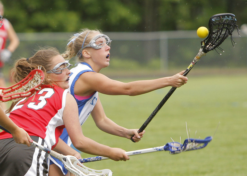 Lauren Errico of Kennebunk recovers the ball during a battle for control against Marty Bushey of South Portland during Kennebunk's 12-5 victory Wednesday.