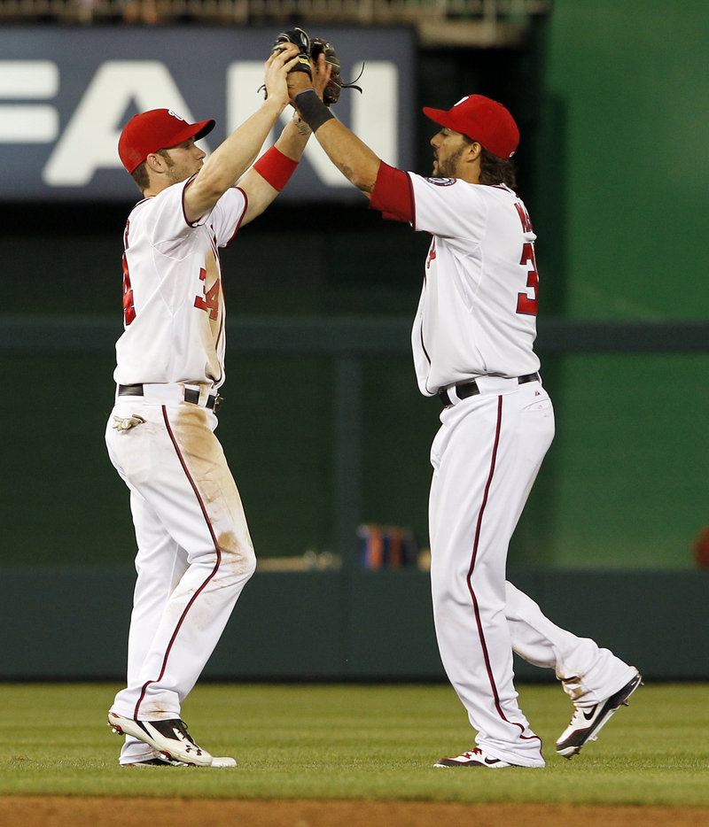 Bryce Harper, left, and Michael Morse celebrate after the Nationals beat the New York Mets 5-3 Wednesday night in Washington.