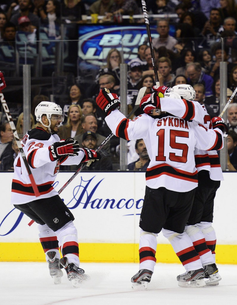 Bryce Salvador, left, and Petr Sykora celebrate a goal by Patrik Elias of New Jersey Wednesday night in Los Angeles. The Devils beat the Kings, 3-1.
