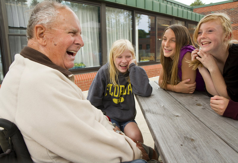 World War II veteran Fernand Gaudreau, 90, shares a laugh Thursday with Scarborough sixth-graders, from left, Jessie Flaherty, Morgan Jackson and Sydnie Pike, at the Maine Veterans' Home.