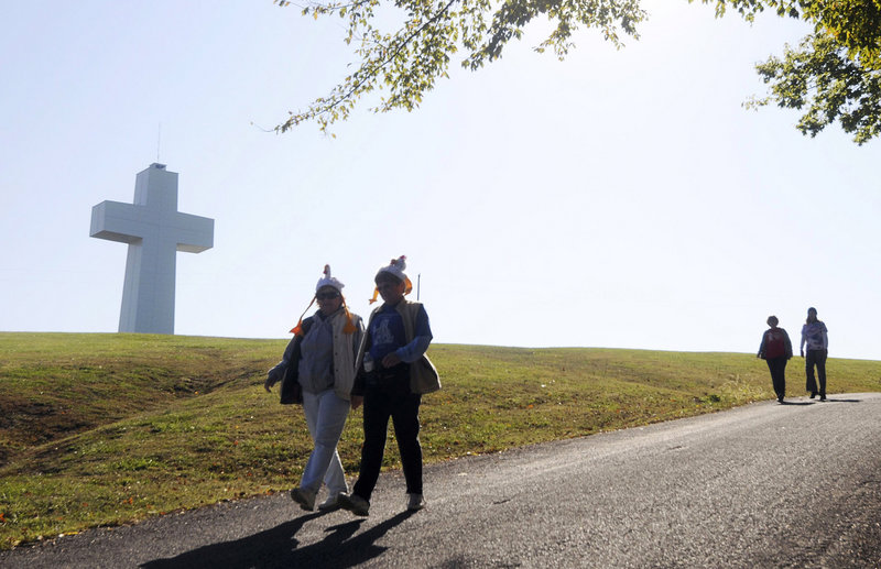 Visitors walk past the 111-foot-high Bald Knob Cross of Peace near Alto Pass, Ill.