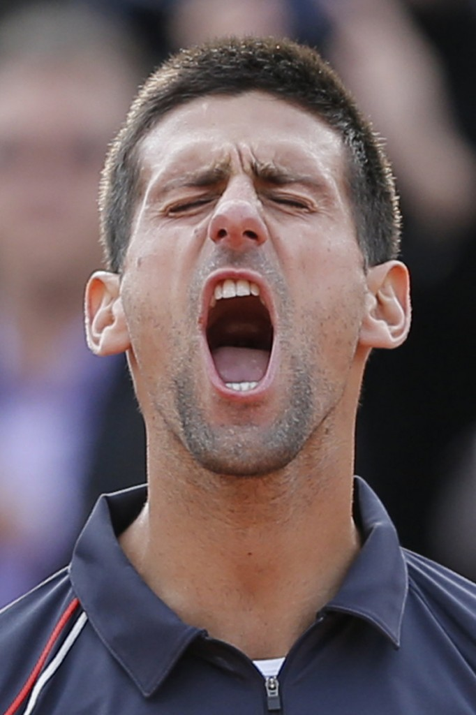 Novak Djokovic celebrates after winning Friday's French Open semifinal match against Roger Federer in Paris.