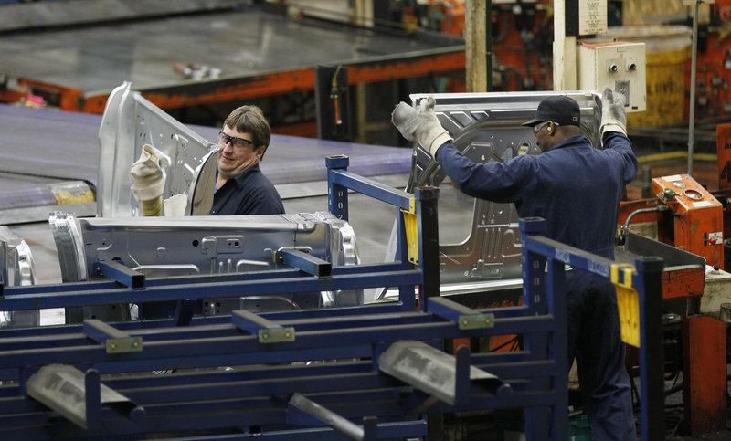 Auto workers at the Ford Stamping Plant in Chicago Heights, Ill., stack the inner door panel for a Ford Explorer in April. Ford is among the U.S. companies feeling the impact of Europe's financial crisis.