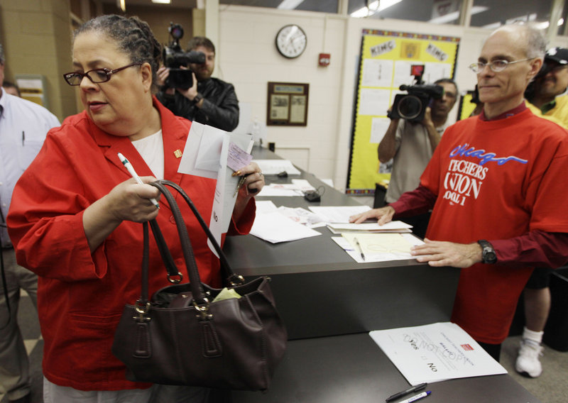 Chicago Teachers Union President Karen Lewis casts her ballot during a strike authorization vote at a Chicago high school this week. The results will be known next week.
