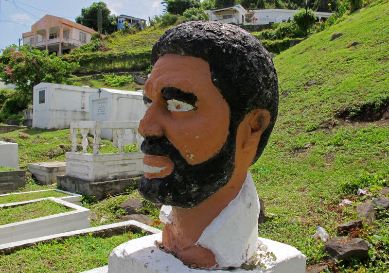 A bust of Grenada's former Prime Minister Maurice Bishop occupies a corner of a sprawling hillside cemetery where forensic experts believe the executed leader's body was buried in an unmarked grave in 1983 in St. George's, Grenada.