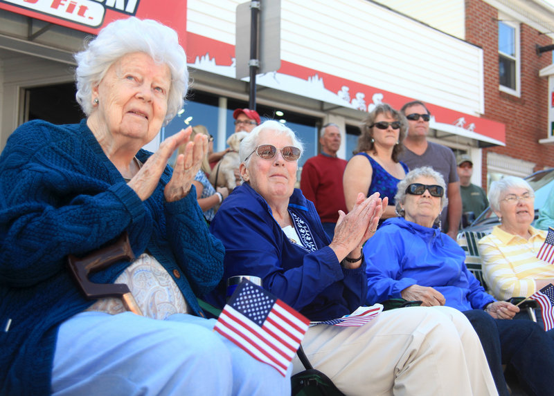 Anita Savage, left, and Elaine Chadbourne cheer as the parade passes down Main Street on Saturday.