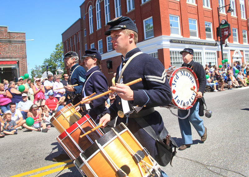 Members of Company A, 3rd Maine Regiment Volunteer Infantry fill the air with music.