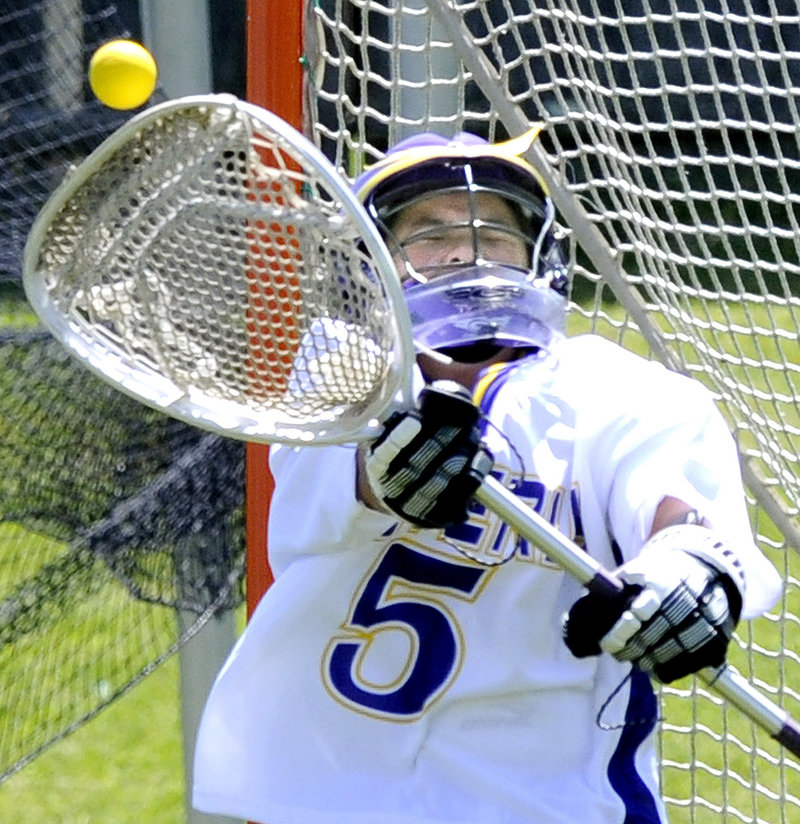Cheverus goalie Hope Correia makes a save Saturday in an Eastern Class A semifinal against Messalonskee. Cheverus won 10-9, and will play top-seeded Brunswick in the regional final Wednesday.