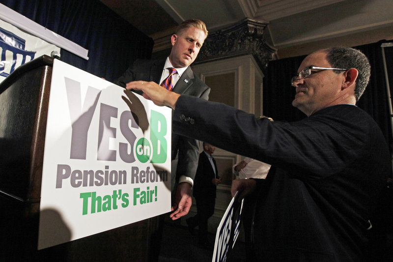 Backers of a proposal to roll back public pensions prepare for a rally Tuesday in San Diego. A similar proposal was also on the ballot in San Jose, and voters in both cities supported the measures. Legal challenges have been filed in both cities.