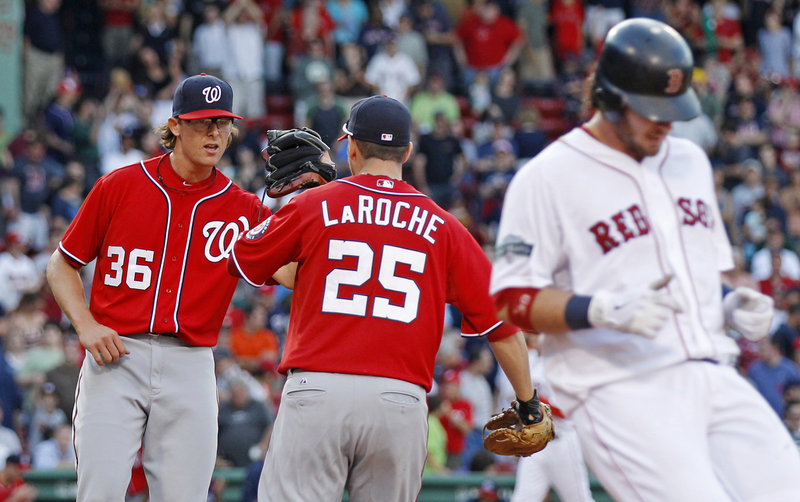 Tyler Clippard, left, celebrates with Adam LaRoche after Washington's 4-2 win Saturday over the Red Sox at Fenway Park.