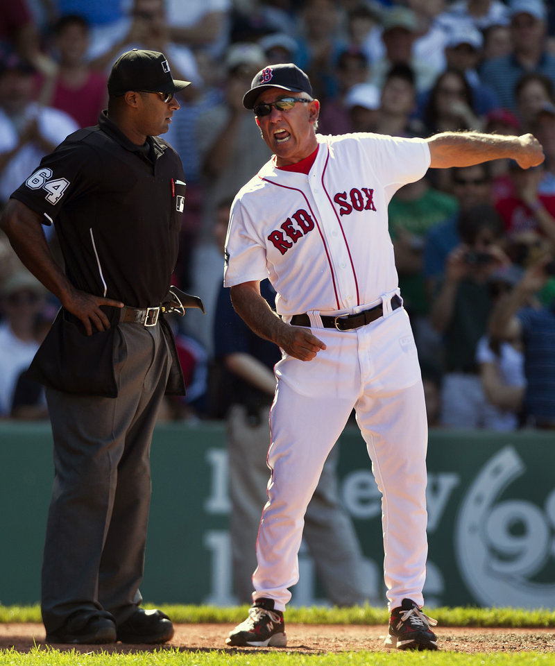 Red Sox Manager Bobby Valentine argues with home plate umpire Al Porter in the ninth inning Sunday. Valentine was thrown out for arguing balls and strikes.