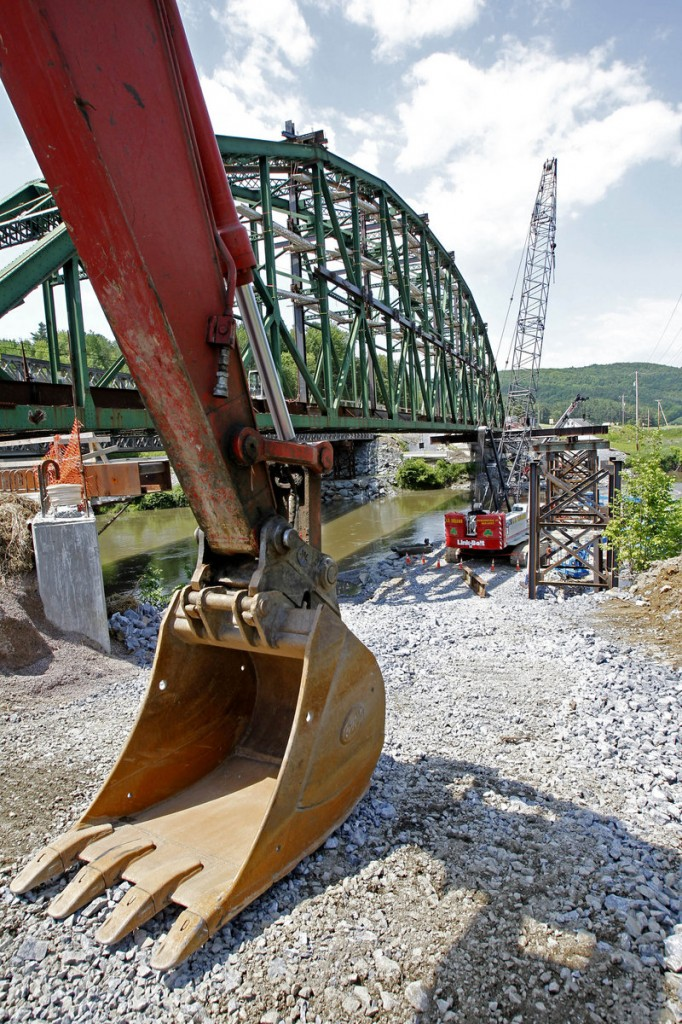 The Checkered House Bridge is under construction in Richmond, Vt. Engineers will separate the sides, move one 300,000-pound truss 10 feet away from the other and then reattach the sides.
