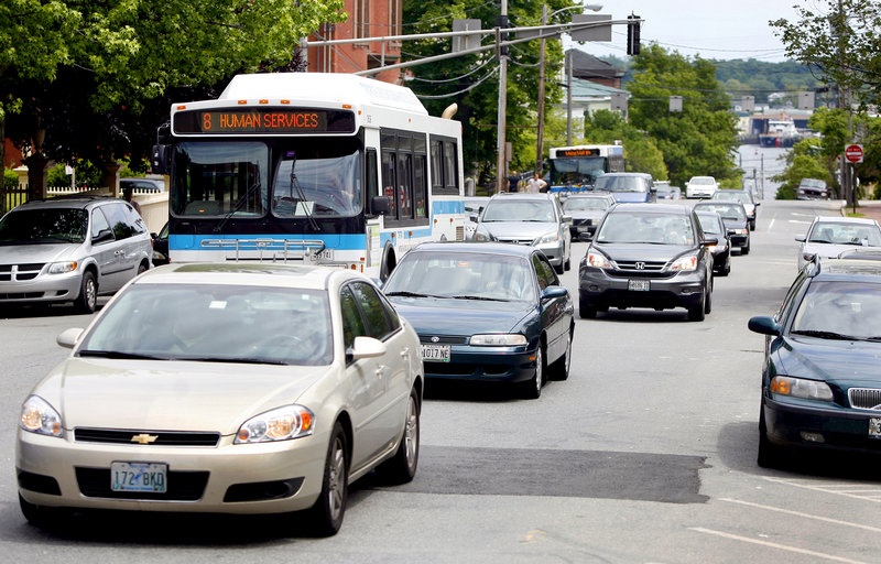 Traffic moves up High Street in Portland on Monday. A city proposal would make traffic on the street two-way once again.