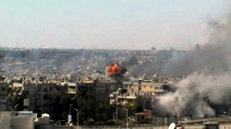 This image taken from amateur video shows explosions rocking the central Syrian city of Homs on Monday.