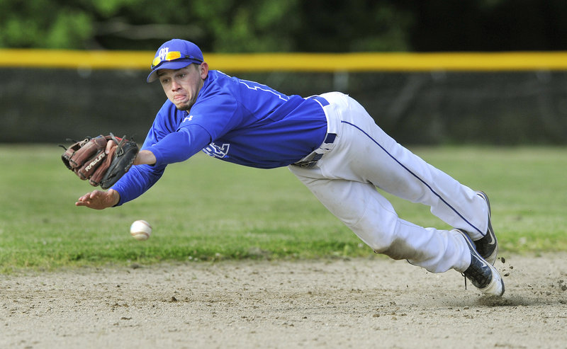 Morse shortstop Zack Groat dives in vain for a ball hit by Falmouth's Connor Murphy in the sixth inning Monday. Murphy's single started a three-run inning that gave Falmouth a 3-0 victory.