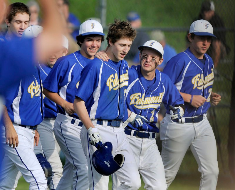 Ryan Conley is congratulated by his Falmouth teammates after hitting a two-run homer in the sixth inning Monday to break a scoreless tie against Morse in a Western Class B baseball semifinal. Falmouth won 3-0, and will face Cape Elizabeth for the regional title Wednesday.