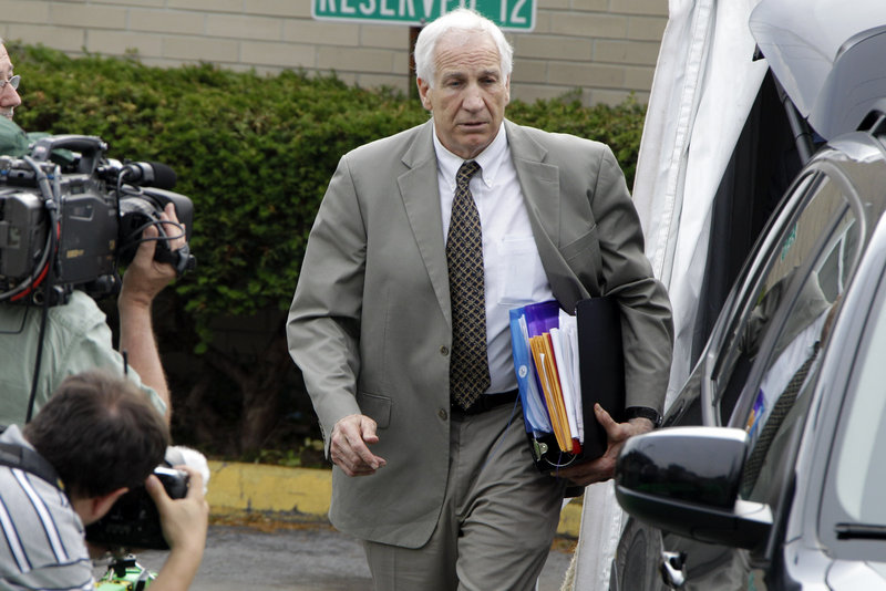 Former Penn State assistant football coach Jerry Sandusky leaves the courthouse Monday after the first day of his trial in Bellefonte, Pa., on 52 counts of child sexual abuse.