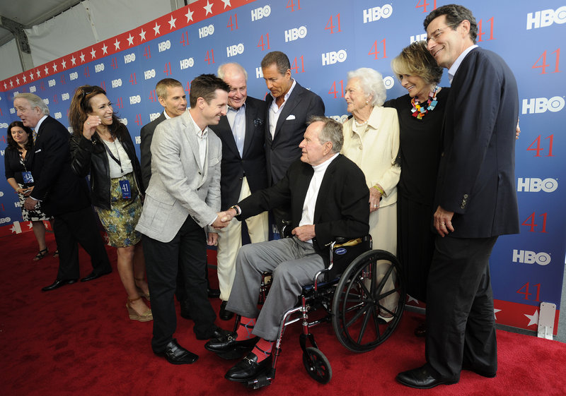 "Jeffrey Roth, the director of the HBO documentary ""41,"" greets the former president as George and Barbara Bush arrive for a special early screening of the film, which Bush narrates."