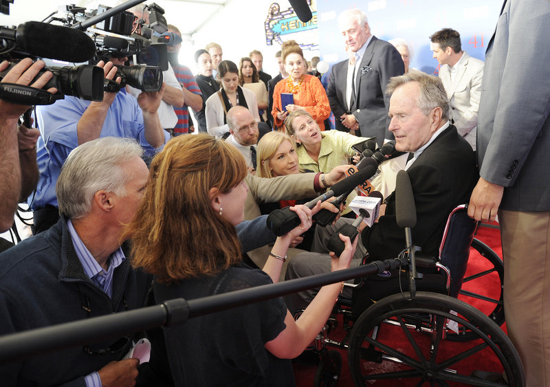 "Reporters mob former President George H.W. Bush on the red-carpeted entrance to the temporary Kennebunkport Playhouse on Tuesday where he celebrated his 88th birthday with a special screening of ""41,"" the new HBO documentary about his life. The screening was held inside a metal-and-glass structure on the grounds of St. Ann's Episcopal Church."