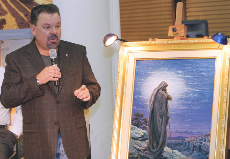 "Thomas Kinkade unveils his painting ""Prayer For Peace"" in 2006. His widow and his girlfriend are at odds over whether his will should be discussed in open court."