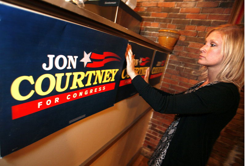 Megan Sanborn, Jon Courtney's stepdaughter, prepares for his primary night party at Pat's Pizza in Portland. The near-final vote was 14,547 to 14,282, Courtney over Patrick Calder.