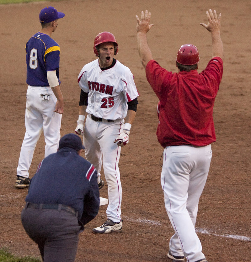 Ben Greenberg of Scarborough celebrates on third base Tuesday night after hitting a leadoff triple in the fifth inning. Greenberg then scored on a sacrifice fly by Aaron Ravin.