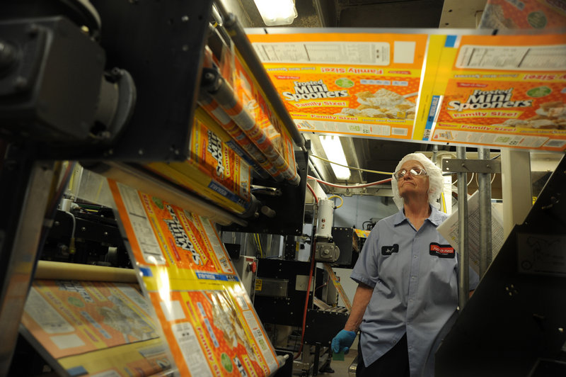 Joann Flicek keeps an eye on a Frosted Mini Spooners bagging machine at MOM Brands, formerly known as Malt-O-Meal. From 2001 to 2011, the company's annual sales climbed from $300 million to about $750 million.