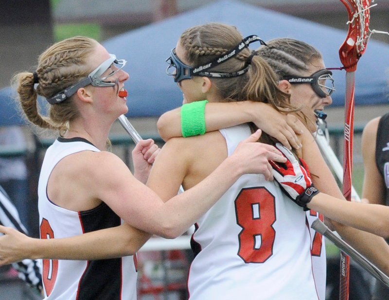 Avery Pietras, No. 8, is congratulated by Maggie Smith, left, and Sarah Martens after scoring the third goal of Scarborough's 13-3 victory against Marshwood.