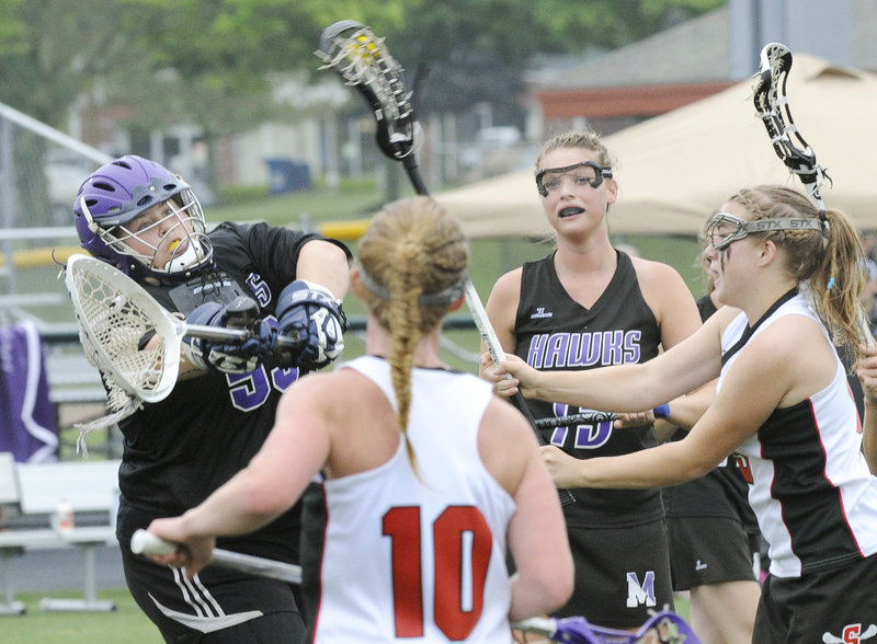 Kelsey Howard, right, of Scarborough fires a shot past Marshwood goalie Meghan Lewis to score the fourth goal for the Red Storm during a 13-3 victory Wednesday in the Western Class A girls' lacrosse final. Scarborough will seek its third consecutive state championship Saturday.