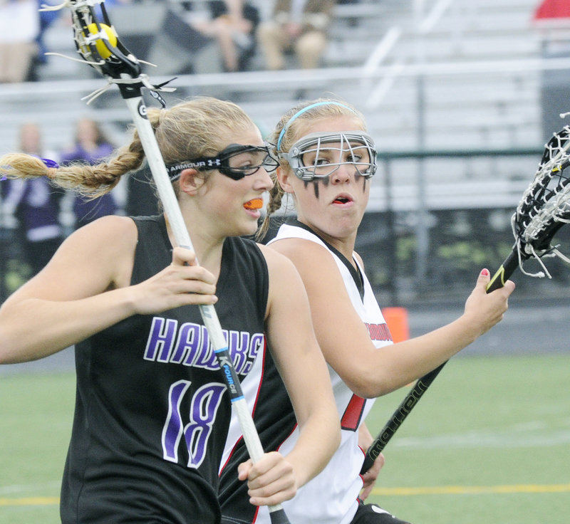 Korinne Bohunsky, left, of Marshwood is chased by Kat Gadbois of Scarborough during their Western Class A final. Scarborough will meet Cheverus or Brunswick, who play today, in the state championship game.
