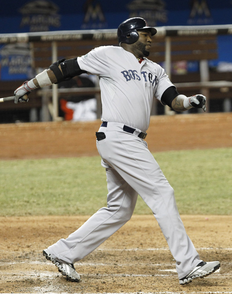 David Ortiz drove in three runs and hit a home run Wednesday night as the Boston Red Sox crushed the Marlins 10-2 at Miami. Ortiz has 15 home runs this season.