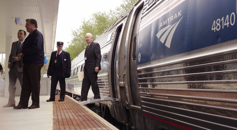 Ed Bonney, chairman of the Freeport Train Committee, steps off the Downeaster in Freeport on May 14. Higher-than-expected bids for a train layover facility in Brunswick are forcing Maine rail officials to re-examine their plans.