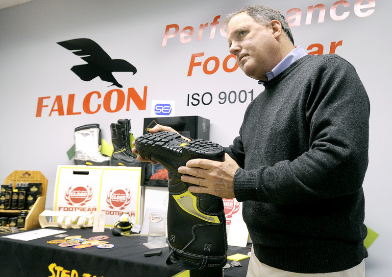 Carl Spang, president of Falcon Performance Footwear, shows a boot that the company manufactures for firefighters.
