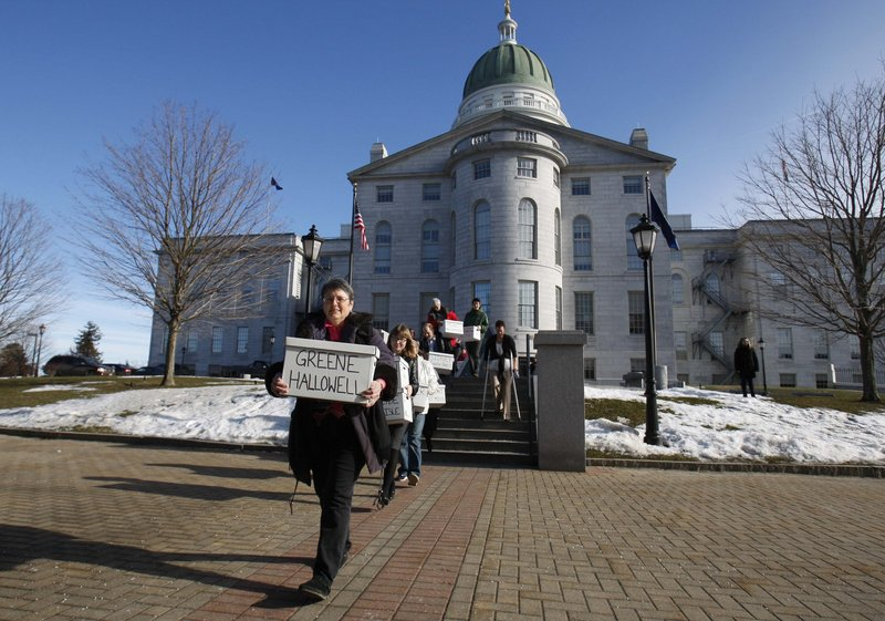 """Gay-marriage supporters carrying signed petitions to the Secretary of State's Office in Augusta. Secretary of State Charlie Summers released the proposed wording of the November ballot question last week: """"Do you want to allow same-sex couples to marry?"""""""