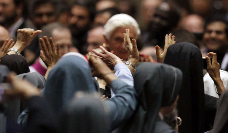 Pope Benedict XVI is greeted by nuns during a meeting with priests and religious in Milan, Italy, on June 2. Benedict has been trying to restore Catholic traditions he believes were lost 50 years ago in the modernizing reforms of the Second Vatican Council.