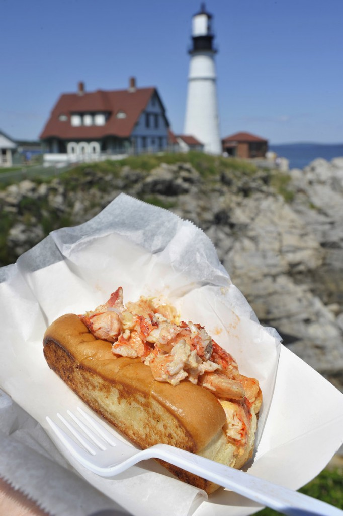 With scenic Fort Williams Park in Cape Elizabeth – and Portland Head Light – as a backdrop, the Bite Into Maine food truck serves a variety of nontraditional lobster rolls, including the curry roll.