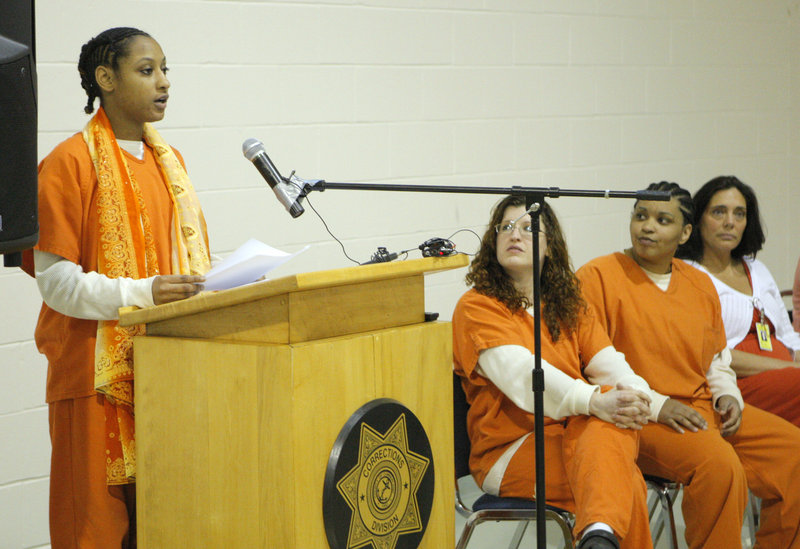 "Regina Goins reads her story ""Strengthen Oneself"" at the Cumberland County Jail on Friday. A dozen women participated in the jail's Sister Stories writing program."