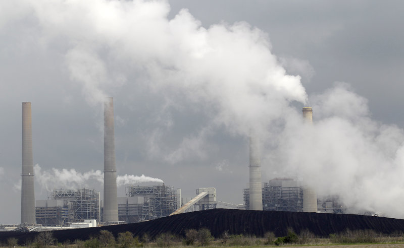 Exhaust rises from smokestacks at an electric generating station in Thompsons, Texas. Soot from such sources is blamed for health problems ranging from asthma to cancer.