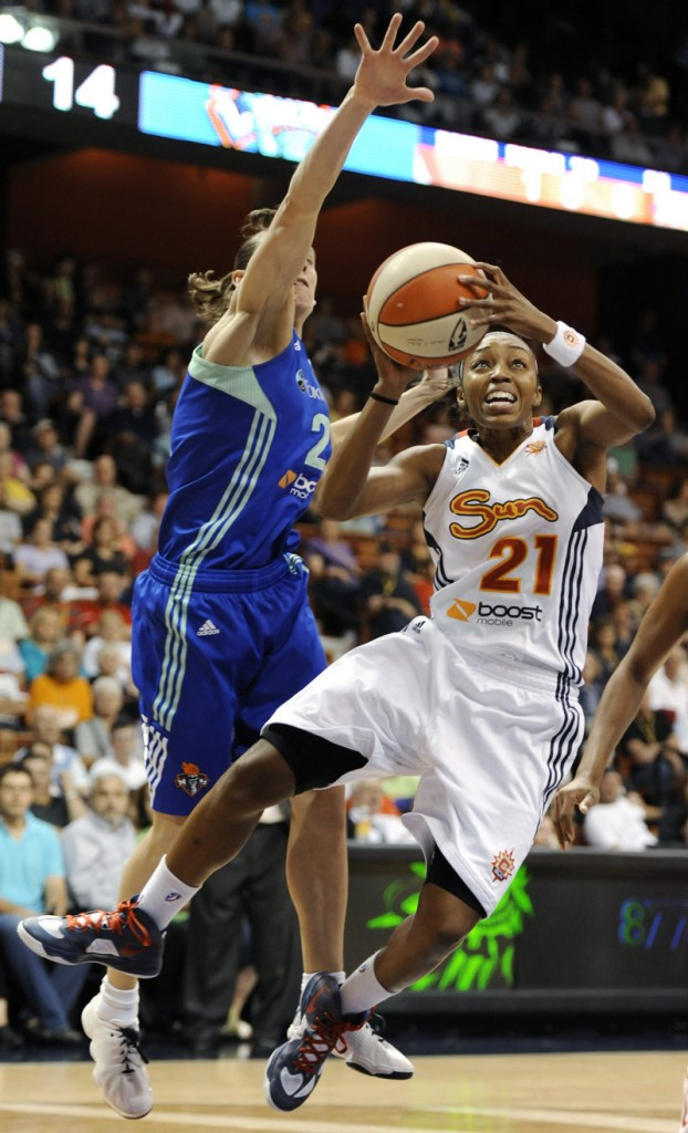 Renee Montgomery of the Connecticut Sun drives against Kelly Miller of the New York Liberty during Connecticut's 97-55 rout.