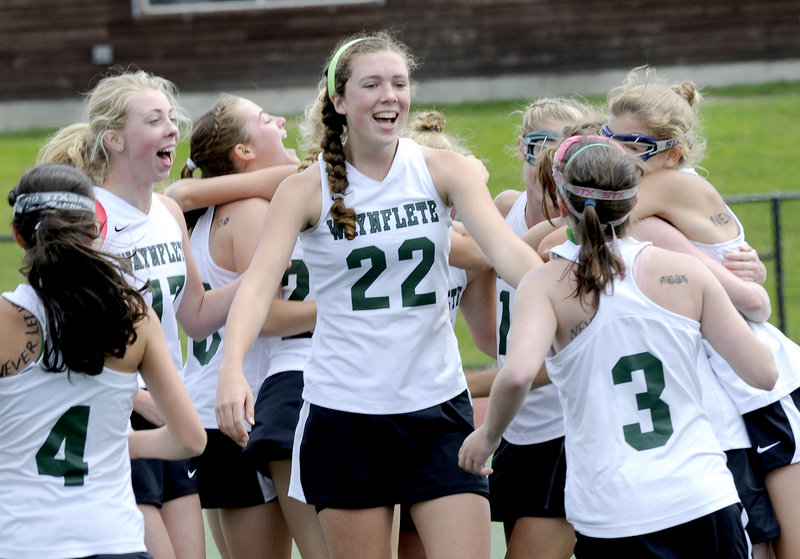 Jo Moore, center, and the Waynflete girls' lacrosse team celebrated their second straight Class B title after beating Freeport, 16-5.