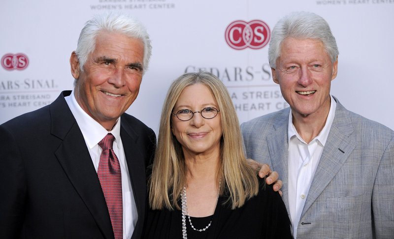 Former President Clinton, right, poses with Barbra Streisand and her husband, James Brolin, on Thursday at Streisand's oceanfront compound in Malibu, Calif.