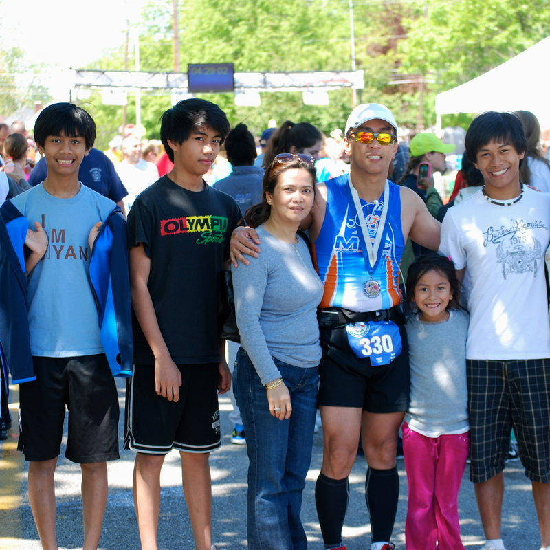 Dr. Aquilino Alamo of Boothbay Harbor, wearing sunglasses, and family, from left, Kyle, Karl, wife Chat, Ariel and Jude, celebrate his finish at the Gettysburg North-South Marathon in April.