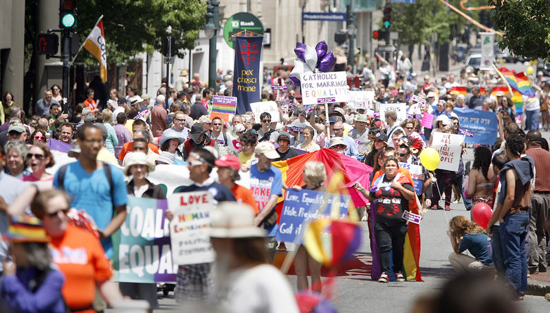 The Southern Maine Pride Parade makes its way down Congress Street in Portland on Saturday. Many marchers carried signs in support of the upcoming vote on gay marriage.