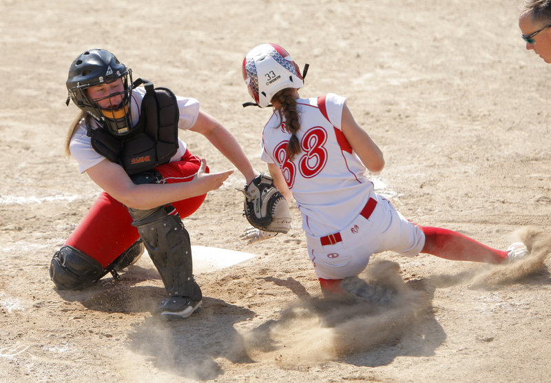 South Portland catcher Sam DiBiase tags out Nicole Rugan of Cony during the Class A softball championship game. Cony finished a 22-0 season with a 2-0 victory.