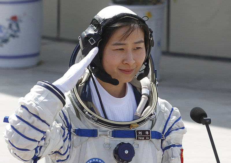Liu Yang, China's first female astronaut, departs for the launch pad at the Jiuquan Satellite Launch Center in Jiuquan on Saturday.